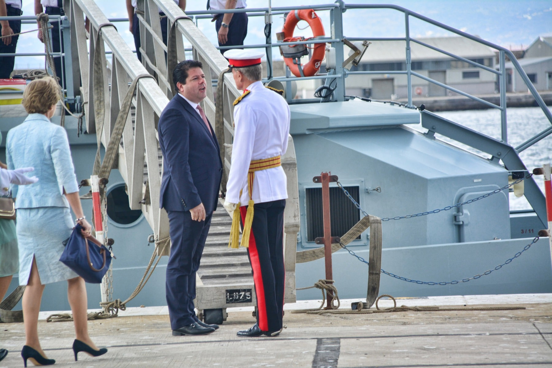 Gibraltar -28th September 2015 - The Governor of Gibraltar today departed From office bidding Farewell to politicians and the armed Forces in what ended up to be a low Key ceremony. A short farewell ceremony at the Parliament lobby was followed by a quick farewell at the city Hall, defer he inspected troops at the Naval Base. He then boarded HMC Seeker where a 17 gun salute bid him farrwell.