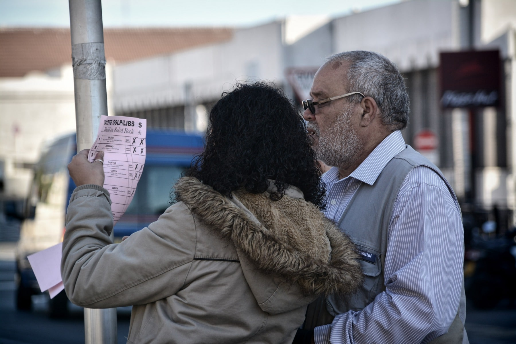 "Gibraltar - 26th November 2015 - (Both Joe Bossano for GSLP/Libs and Kim Karnani Santos attended Line Wall Road where tensions were high at one point this morning). Police were today requested to make their presence known at the polling station by Line Wall Road after GSD activists handing leaflets outside the polling station are alleged to have made complaints over the use of the language used by a GSLP/Liberal activist handing leaflets to voters of Moroccan origins.According to reports received by Core Photography the GSD activists complained that the use of the native Moroccan language should not be allowed by those guiding voters outside the polling station, claiming the ""official language in Gibraltar is English,"" according to witnesses present during the incident. This resulted in tensions between the activists. Police were present to calm down the situation which has been played down as a minor incident. Executive members of the GSD approached over the incident have indicated that they were not at the time aware of such an incident, but have indicated that they would not support such actions and would be looking into the matter.No further known incidents have been reported throughout the day.Voting has been steady throughout the day, with politicians attending the polling stations throughout the morning as voters queue up to vote.The Commissioner of Police has attended polling stations to oversee security in person."