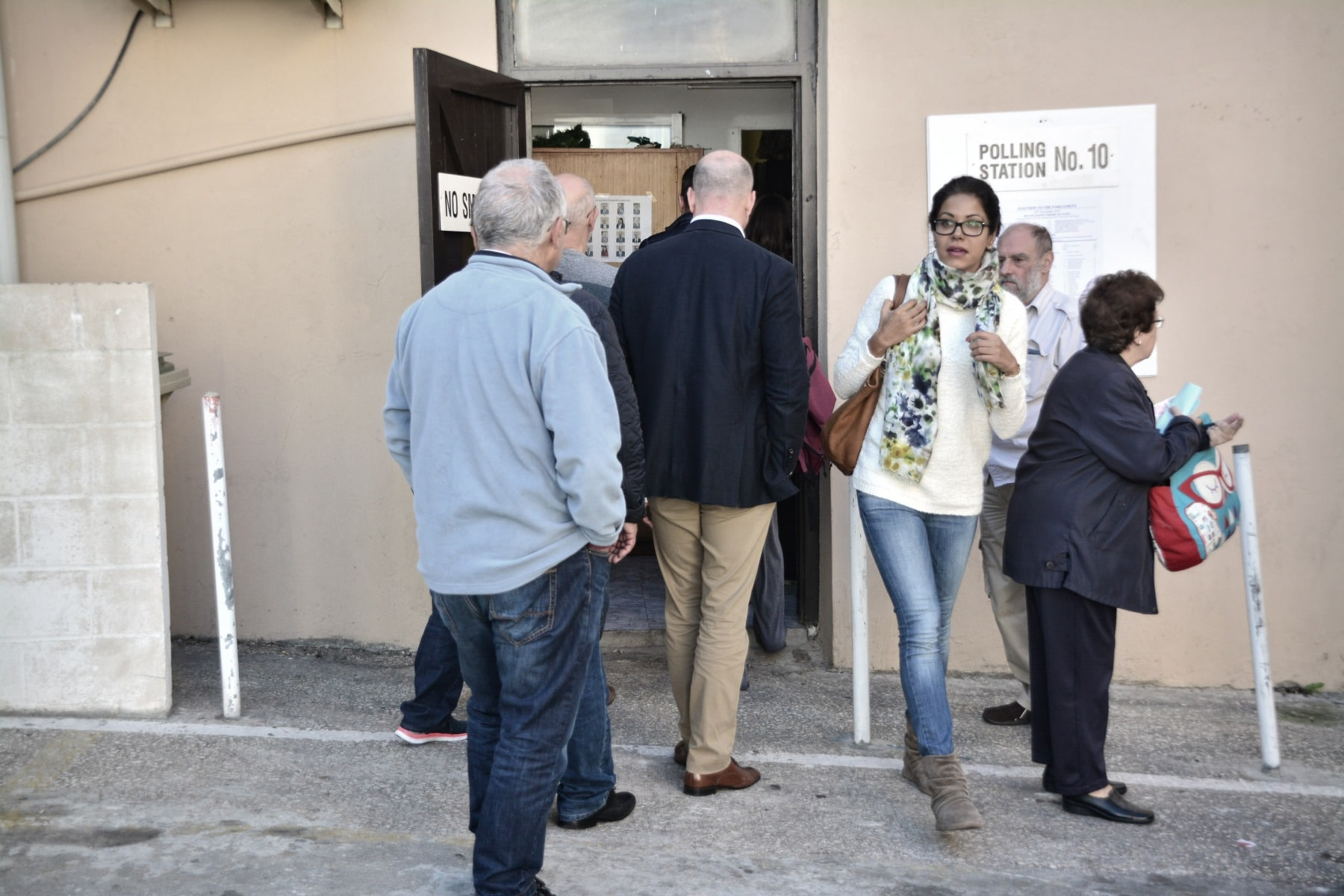 "Gibraltar - 26th November 2015 - (Commissioner of police at Town Range Polling Station as he oversees security) Police were today requested to make their presence known at the polling station by Line Wall Road after GSD activists handing leaflets outside the polling station are alleged to have made complaints over the use of the language used by a GSLP/Liberal activist handing leaflets to voters of Moroccan origins.According to reports received by Core Photography the GSD activists complained that the use of the native Moroccan language should not be allowed by those guiding voters outside the polling station, claiming the ""official language in Gibraltar is English,"" according to witnesses present during the incident. This resulted in tensions between the activists. Police were present to calm down the situation which has been played down as a minor incident. Executive members of the GSD approached over the incident have indicated that they were not at the time aware of such an incident, but have indicated that they would not support such actions and would be looking into the matter.No further known incidents have been reported throughout the day.Voting has been steady throughout the day, with politicians attending the polling stations throughout the morning as voters queue up to vote.The Commissioner of Police has attended polling stations to oversee security in person."