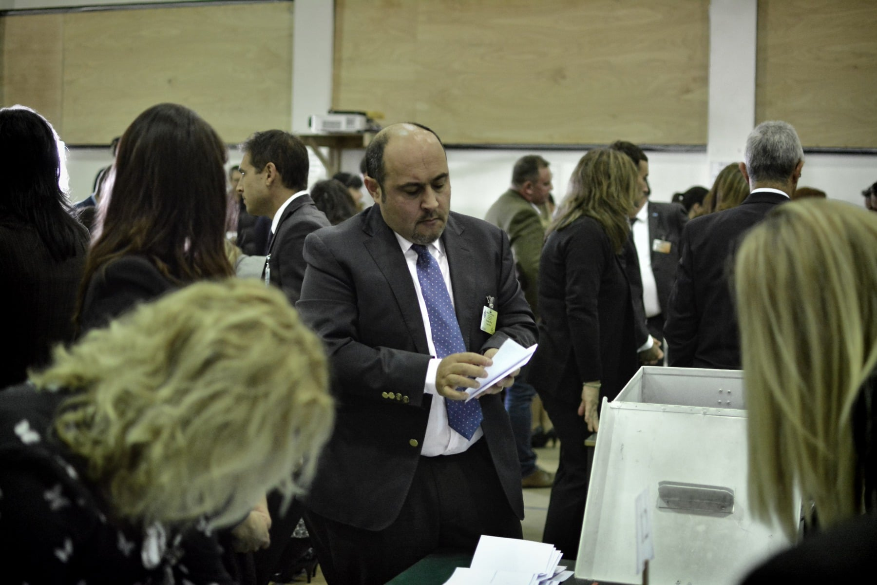 Gibraltar - 27th November 2015 - With security around John Macintosh Hall tightened, the first ballot box surprised everyone arriving dead on 10pm, the time polling stations were supposed to close their doors. A stream of ballot boxes then arrived as GBC announced the results of their exit poll putting the GSLP/Liberal Alliance ahead with 72%. As counting started by midnight candidates started to arrive at John Macintosh Hall where the count is taking place.One of the first candidates to arrive was John Cortes, followed by Edwin Reyes. Moments later Joseph Garcia, Gilbert Licudi, Albert Isola and Steven Linares arrived to a somewhat quite JHM as counting started.The verification count was overseen by agents of both parties, with the Governor Alison Macmilan also visiting JMH to oversee the protocols being followed, as is traditional during general elections in Gibraltar.John Macintosh Hall also saw tonight armed patrols present around the area, in keeping with the high security alert status presently experienced in Gibraltar. The security detail deployed included the presence of an inspector within the armed response detail, this being one of the few occassions in which a high ranking officer has been seen present as part of the unit when in public.