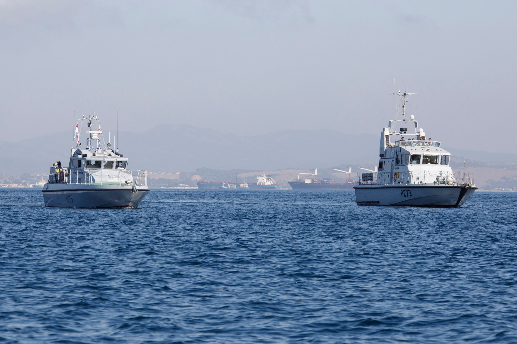 Royal Navy Gibraltar Squadron with four boats at sea.