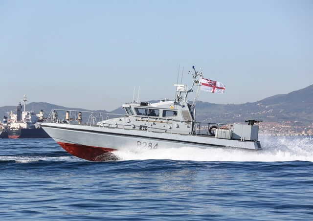 HMS Monmouth visiting HMNB Gibralatr escourted by HMS Scimitar and HMS Sabre, Gibraltar Squadron, Royal Navy